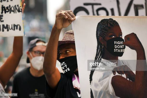 Activists from One Fair Wage hold a demonstration in Times Square to demand a 'fair wage' for tipped workers during coronavirus and beyond on August...
