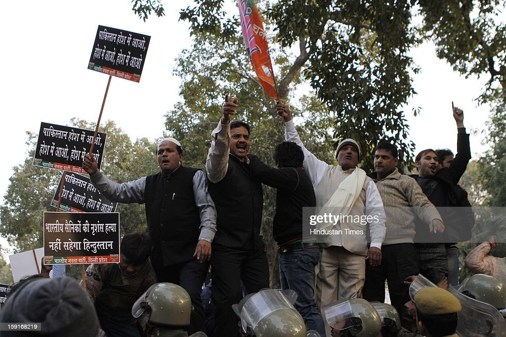 Activists from opposition Bharatiya Janata Party shout anti-Pakistan slogans during a protest march to the Pakistani embassy against the killing of two Indian soldiers on LoC on January 9, 2013 in New Delhi, India. Two Indian soldiers Lance Naik Hemraj and Sudhakar Singh were killed allegedly by infiltrating Pakistani soldiers inside Indian border at LoC. Pakistan has denied involvement of its troops in an attack and said it was prepared to hold investigations through the UN Military Observer Group on the recent ceasefire violations on the Line of Control(LoC).