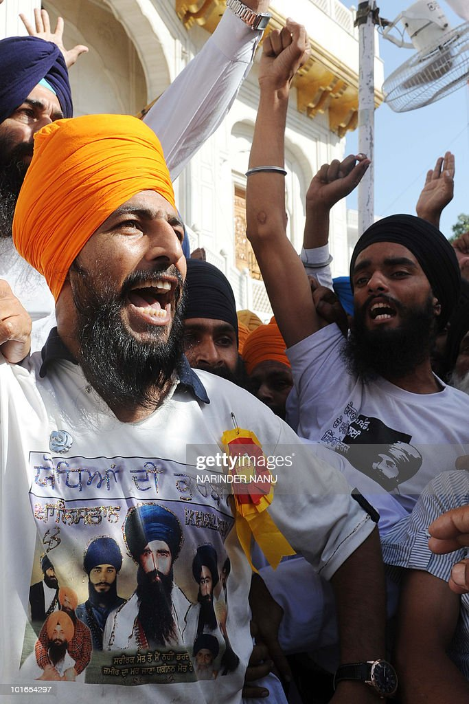 Activists from radical Sikh organisations shout slogans in support of Sikh leader Sant Jarnail Singh Bhindranwale and Khalistan, the name for an envisioned independent Sikh state, after prayers at Sri Akal Takht at the Golden Temple in Amritsar on June 6, 2010. 'Ghallughara Diwas' is the anniversary of the deadly 1984 Indian army 'Operation Bluestar' assault on the Golden Temple complex to arrest Sant Jarnail Singh Bhindranwale, a Sikh leader and his militant followers who had initiated a movement for a separate Sikh state.