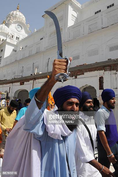 Activists from radical Sikh organizations shout slogans in support of Sikh leader Sant Jarnail Singh Bhindranwale and Khalistan, the name for an...