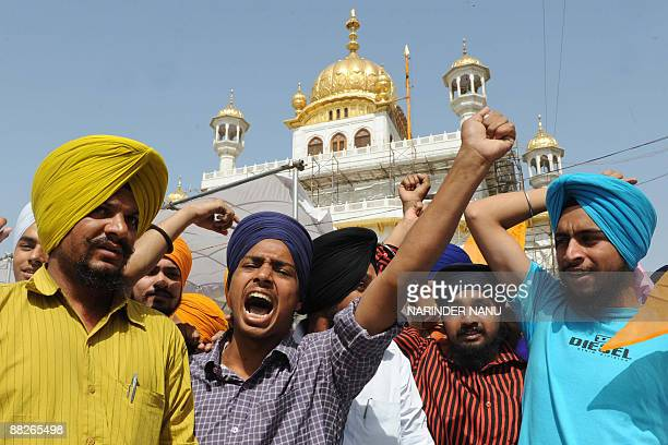 Activists from radical Sikh organizations shout slogans in supporter of Sikh leader Sant Jarnail Singh Bhindranwale and Khalistan, the name for an...