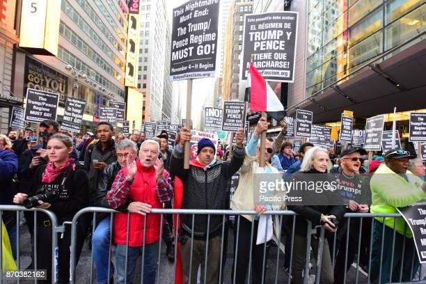 Activists from Revolutionary Club of New York staged a rally in Times Square calling for a week of solid action in mark the one year anniversary of...