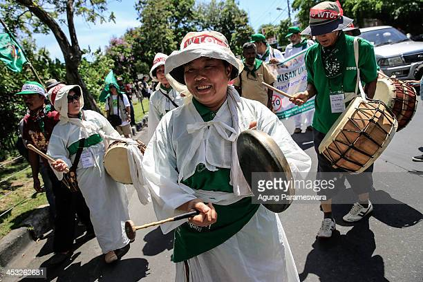 Activists from South Korea play traditional instruments during a protest against the World Trade Organization meeting on December 3 2013 in Denpasar...
