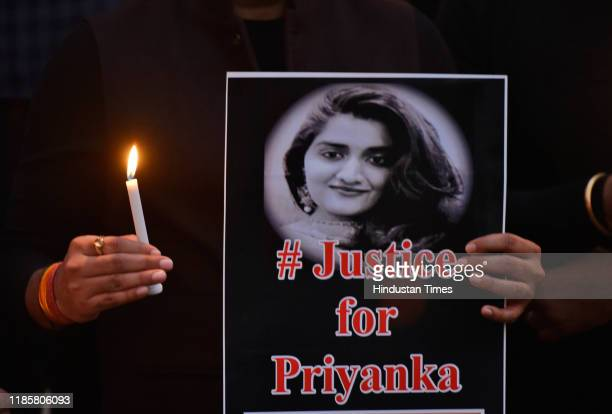 Activists from Swabhiman hold placards during a candle march demanding justice for Hyderabad rape victim, at Jantar Mantar, on December 1, 2019 in...