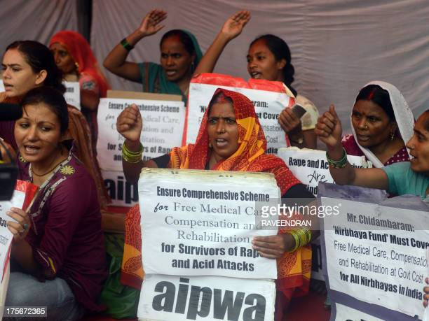 Activists from the All India Progressive Women's Association shout antigovernment slogans against rape and acid attacks on women during a protest...