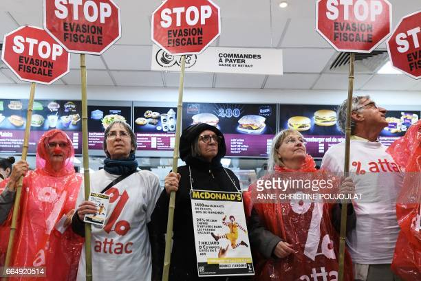 Activists from the association for the Taxation of financial Transactions and Citizen's Action protest in a McDonald's in Marseille on April 5 to...