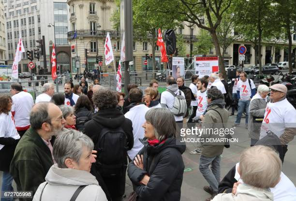 Activists from the Association for the Taxation of financial Transactions and Citizen's Action take part in a demonstration to support 7 ATTAC...