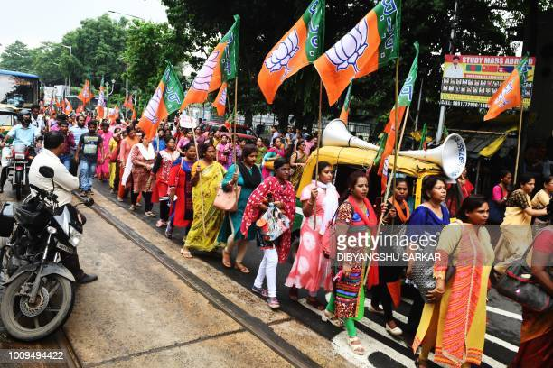 Activists from the Bhartiya Janata Party shout slogans in support of the publication of the first complete draft of the National Register of Citizens...
