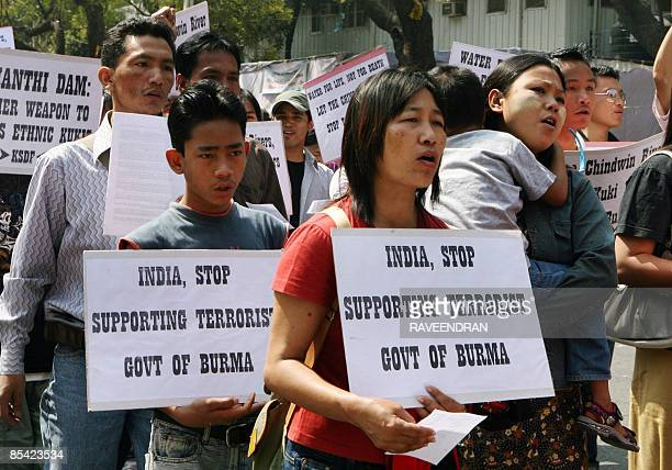 Activists from the Burmese Kuki Students' Democratic Front shout slogans during a protest in New Delhi on March 14 2009 against theTamanthi Dam and...