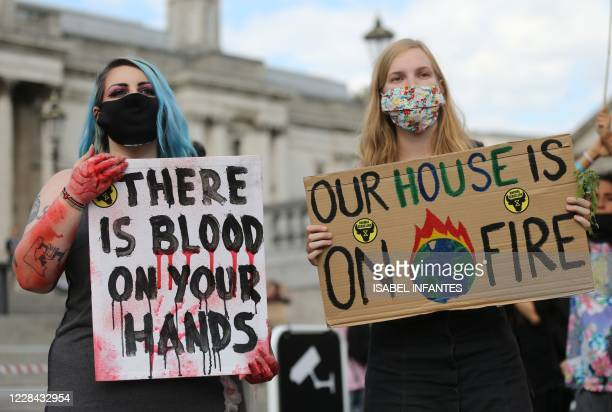 Activists from the climate protest group Extinction Rebellion hold placards in Trafalgar Square in London on September 1 at the start of their new...