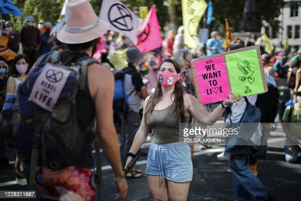 Activists from the climate protest group Extinction Rebellion stage a protest in Parliament Square in central London on September 2, 2020 on the...