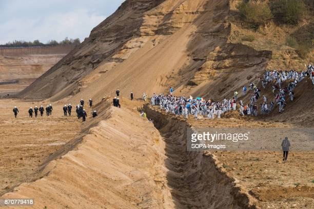 Activists from the collective Ende Gelande and policemen seen standing on the mine site during a demonstration ahead of COP23 As COP 23 is about to...