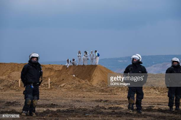 Activists from the collective Ende Gelande seen behind policemen during a demonstration ahead of COP23 As COP 23 is about to launch in Bonn the...