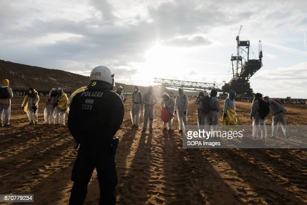 Activists from the collective Ende Gelande seen forming a human line front of a policeman during a demonstration ahead of COP23 As COP 23 is about to...