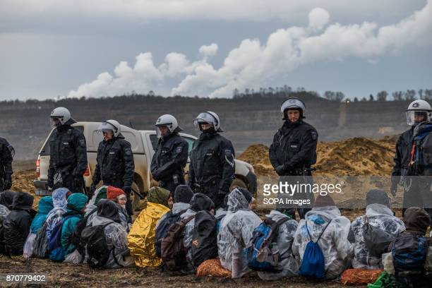 Activists from the collective Ende Gelande seen forming a human line front of the Policemen during a demonstration ahead of COP23 As COP 23 is about...