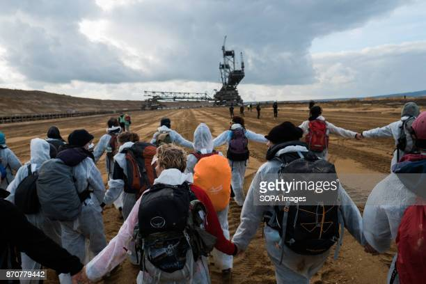 Activists from the collective Ende Gelande seen forming a human line during a demonstration at the mine site ahead of COP23 As COP 23 is about to...