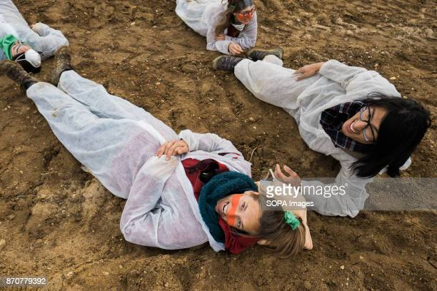 Activists from the collective Ende Gelande seen lying on the floor as a sign of protest on the mine site during a demonstration ahead of COP23 As COP...