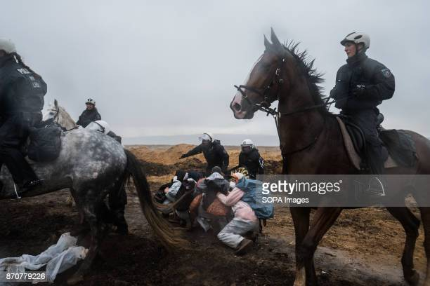 Activists from the collective Ende Gelande seen protecting themself against the policemen during a demonstration ahead of COP23 As COP 23 is about to...