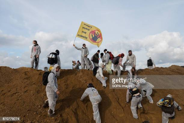 Activists from the collective Ende Gelande seen standing on the mine site during a demonstration ahead of COP23 As COP 23 is about to launch in Bonn...
