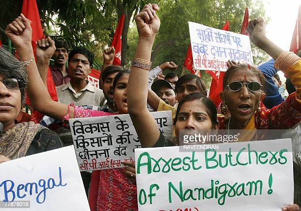 Activists from the Communist Party of India New Democracy shout antigovernment and West Bengal government slogans during a protest against the...