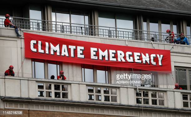 Activists from the environmental action group Greenpeace demonstrate outside the British Petroleum Headquarters in central London on May 20 2019...