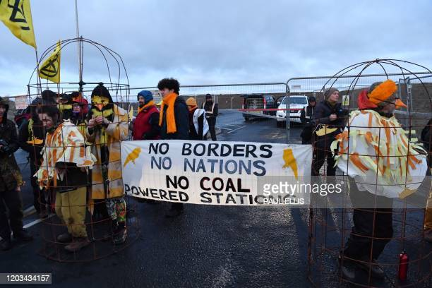 Activists from the Extinction Rebellion climate action group gather to block the entrance to the site of the Bradley opencast coal mine near the...