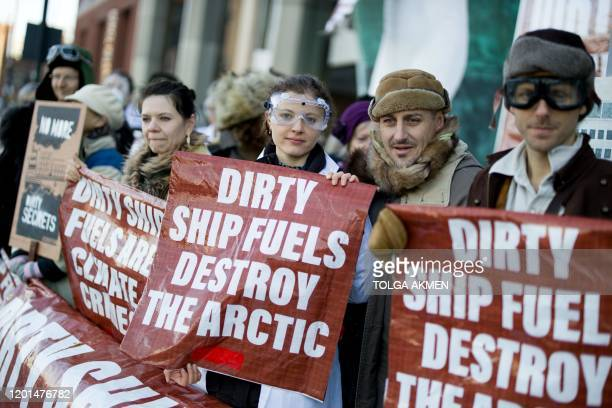 Activists from the Extinction Rebellion climate action group protest outside the International Maritime Organisation in London on February 17 2020...