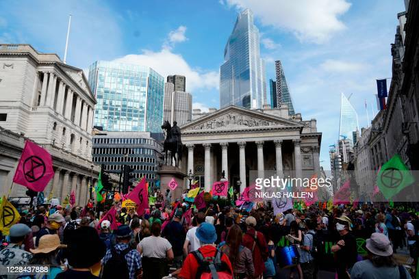 Activists from the Extinction Rebellion climate change group protest at a demonstration outside the bank of England in London on September 10 2020 on...