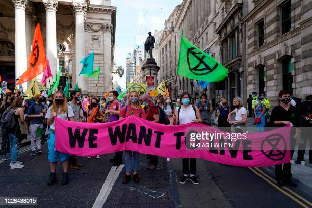 Activists from the Extinction Rebellion climate change group protest at a demonstration outside the bank of England in London on September 10, 2020...