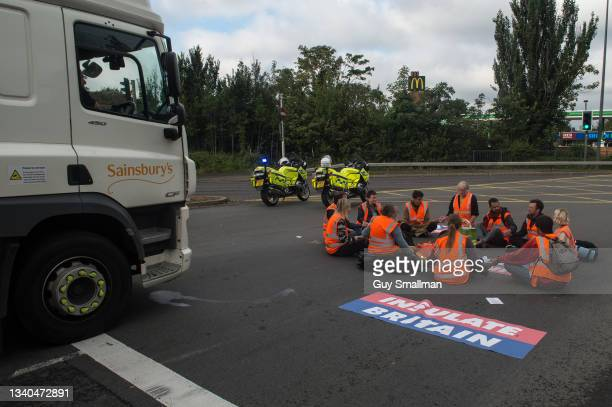 Activists from the Insulate Britain protest group block a major roundabout near the Dartford crossing and M25 on September 15, 2021 inDartford,...
