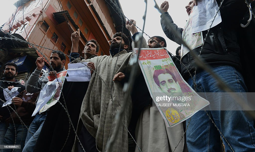 Activists from the Jammu and Kashmir Libration Front (JKLF) shouting anti-Indian slogans demanded the return of Afzal Guru's mortal remains to his family during a protest in Srinagar on March 1, 2013. Separatist alliance, All Parties Hurriyat Conference, opposed to Indian rule in Kashmir called for a one-day strike in to press the demanded for return of Afzal Guru's mortal remains to his family. Guru was executed on February 9, 2013 and buried inside a high security prison in New Delhi after he was convicted of his role in a deadly attack on Indian parliament in 2001. AFP PHOTO/ Tauseef MUSTAFA