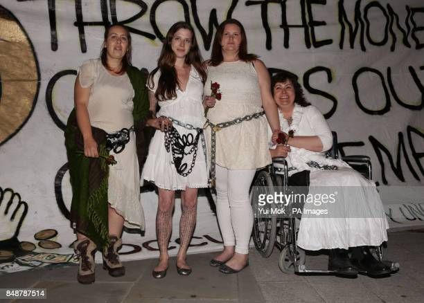 Activists from the Occupy movement Tammy Samede Alison Playford Siobhan Grimes and Josie Reid outside St Paul's Cathedral London after voluntarily...