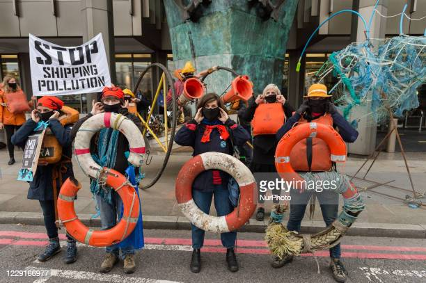 Activists from The Ocean Rebellion stage a protest outside the UN's International Maritime Organisation headquarters on the opening day of...