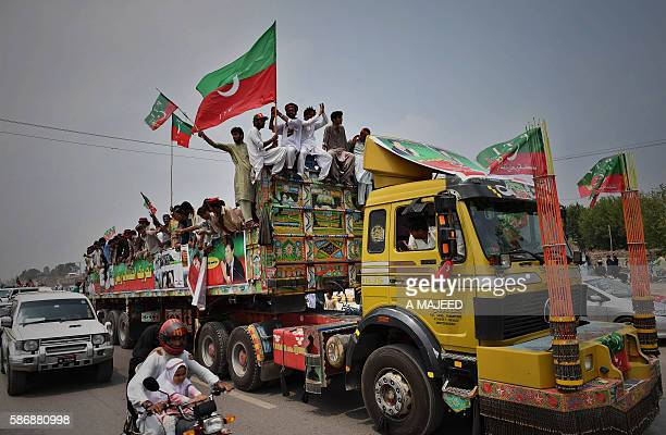 Activists from the Pakistan Tehreek-e-Insaf wave flags and chant slogans at the start of the Tehrik-e-Ehtesab rally in Peshawar on August 7, 2016....