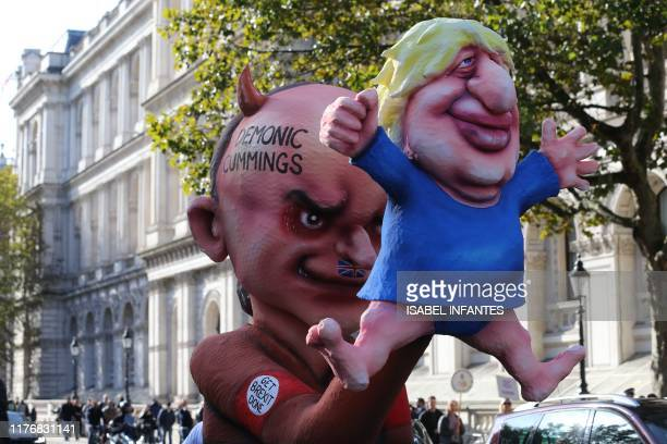 Activists from the People's Vote organisation calling for a second referendum on Brexit unveil an effigy depicting Britain's Prime Minister Boris...
