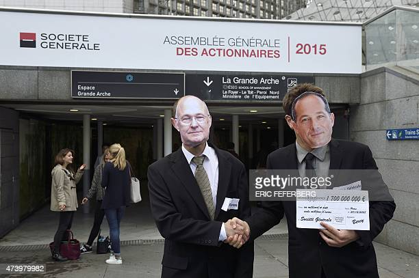 Activists from the 'Sauvons les Riches' collective wearing masks representing French Economy Minister Michel Sapin and French bank Societe Generale...