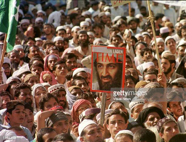 Activists from the SipaheSahaba Pakistan carry a portrait of Saudi dissident Osama Bin Laden September 28 2001 at a rally in Islamabad Pakistan Many...