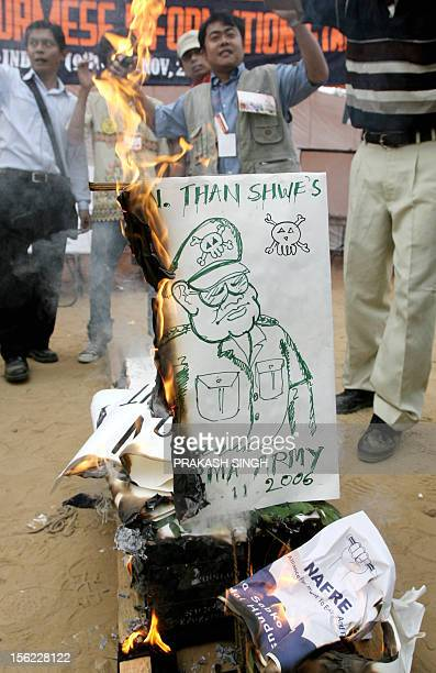 Activists from the Student and Youth Congress of Burma burn a coffin depicting Burmese Army General Than Shwe during the India Social Forum in New...