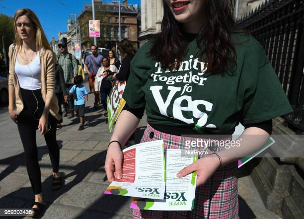 Activists from the 'Trinity Together for Yes' campaign canvass in front of the main entrance to Trinity College urging a 'yes' vote in the referendum...