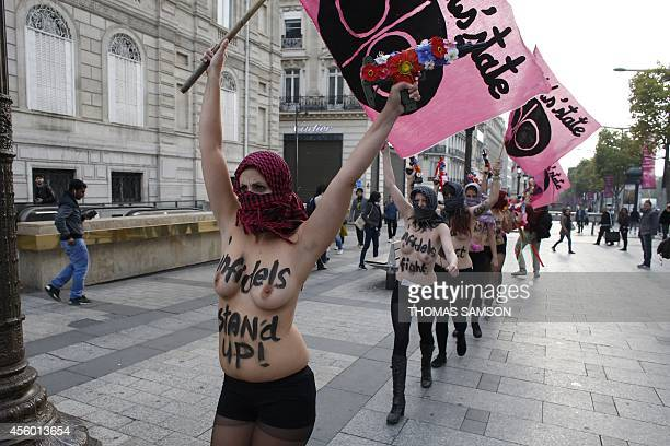 Activists from the women's rights organization Femen protest against ISIL threats urging the deaths of citizens of all countries taking part in the...