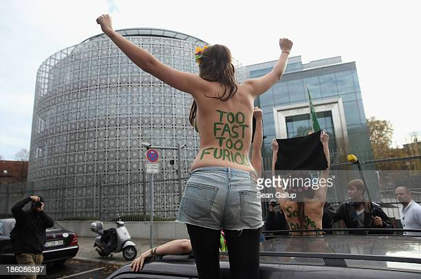 Activists from the women's rightsgroup Femen bear their breasts while protesting outside the Saudi embassy against the prohibition on women driving...