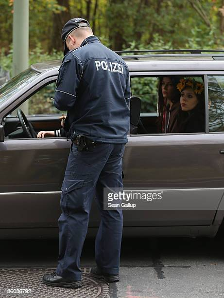 Activists from the women's rightsgroup Femen sit in a car after police stopped four of them for protesting in an unregistered demonstraiton outside...