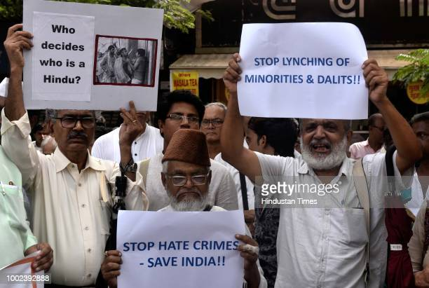 Activists from various organizations held a protest to condemn mob attack on Swami Agnivesh at CSMT on July 19 2018 in Mumbai India