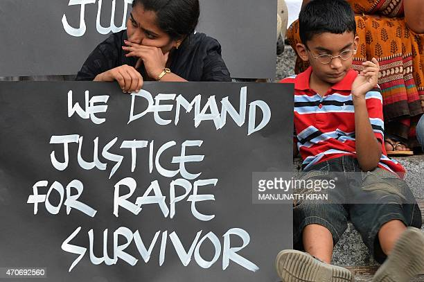 Activists from various women's rights organisation and children stage a silent demonstration against sexual assault and rapes on women in Bangalore...