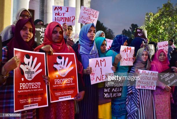 Activists from various women's rights organisations hold placards as they protest against sexual harassment rapes and murders of women across the...