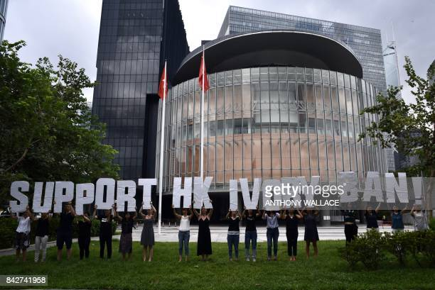 Activists from Wild Aid gather in front of the Legislative Council building holding large letters that read Support HK Ivory Ban in Hong Kong on...