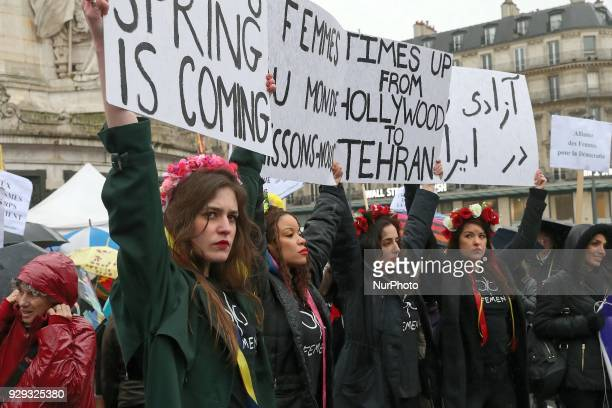 Activists from women's rights movement Femen carry signs on the place de la République in Paris on March 8 2018 during the International Woman's Day...