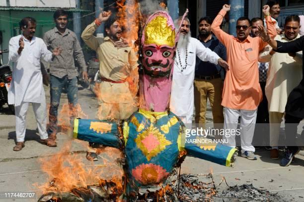 Activists fromShiv SenaTaksalishout slogans as they burn effigies ofPakistan Prime Minister Imran KhanandPakistan Army chiefQamar Javed...