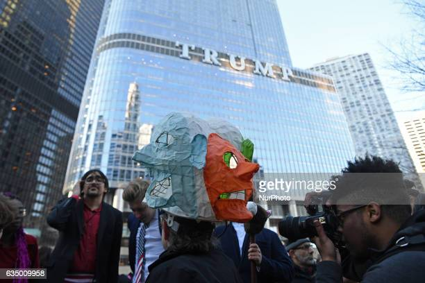 Activists gather across from Trump Tower before pulling down their pants and mooning on February 12 2017 in Chicago Illinois The event was staged to...
