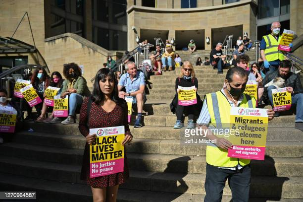 Activists gather at Buchanan Street to demonstrate against the treatment of refugees following the death of Mercy Baguma and Adnan Olbeh on September...